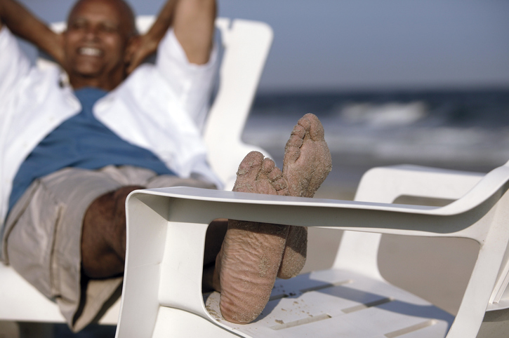 African American man relaxing on beach