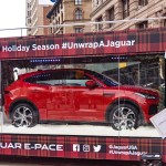 Jaguar holiday bus with an E-Pace SUV