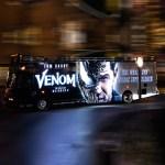 Venom movie illuminated bus on the road