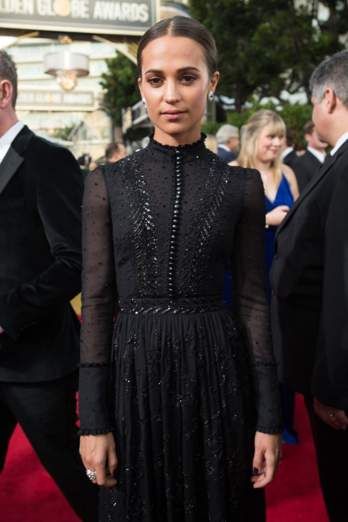 Alicia Vikander arrives at the 75th Annual Golden Globe Awards