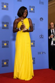 """After winning the category of BEST PERFORMANCE BY AN ACTRESS IN A SUPPORTING ROLE IN A MOTION PICTURE for her work in """"Fences,"""" actress Viola Davis poses backstage in the press room with her Golden Globe Award at the 74th Annual Golden Globe Awards at the Beverly Hilton in Beverly Hills, CA on Sunday, January 8, 2017."""
