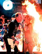 James Hetfield and Lady Gaga sharing a microphone