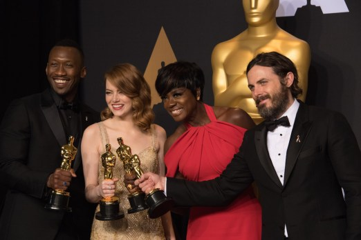 Backstage posing with their Oscars®, Mahershala Ali, Actor in a Supporting Role; Emma Stone, Actress in a Leading Role; Viola Davis, Actress in a Supporting Role; and Casey Affleck, Actor in a Leading Role backstage during The 89th Oscars® at the Dolby® Theatre in Hollywood, CA on Sunday, February 26, 2017.