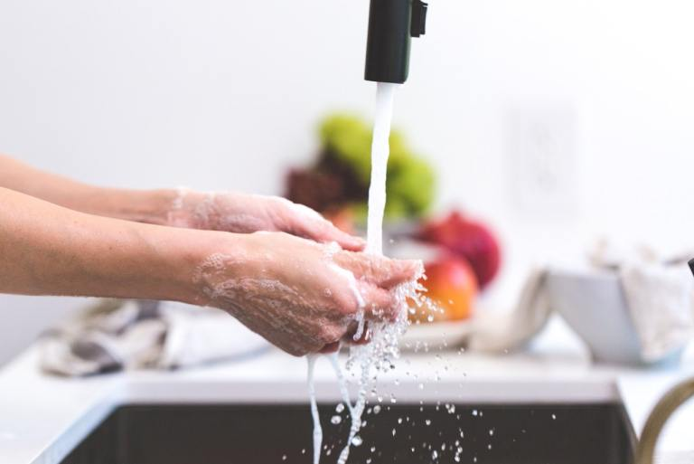 washing hands in kitchen