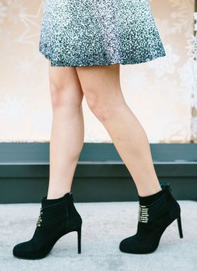 sydne-style-wears-black-suede-booties-with-a-sequin-skirt