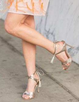 sydne-style-wears-vince-camuto-gold-lace-up-sandals-with-tassels