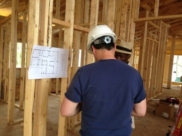 Electrician checking the plans