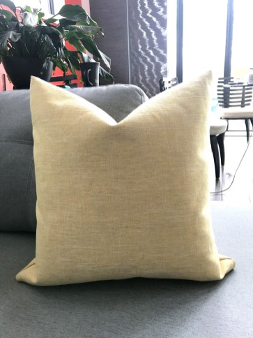 Completed throw pillow cover in Trent Naples Yellow fabric from Tonic Living