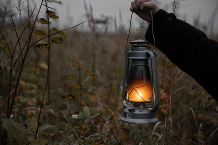 holding-a-lantern-with-fire