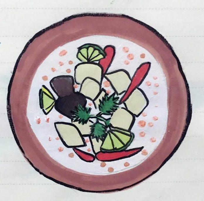 Asiatische Kokossuppe mit Fisch