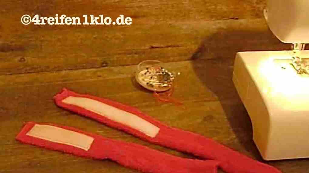 Festgenähtes Klebeband auf den Haltebändern