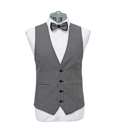 Black and white small check waist coat with matching dicky bow tie on a manikin wearing a white shirt 3