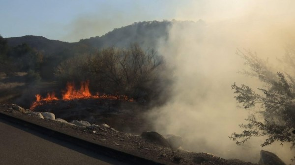 Helicopters attempt to tame California wildfire