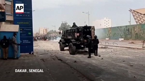 1 dead in Senegal protests backing opposition lead