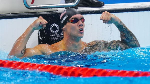 Swimmer Caeleb Dressel powers to 4th gold with victory in 50-meter freestyle; Bobby Finke wins 1,500 free