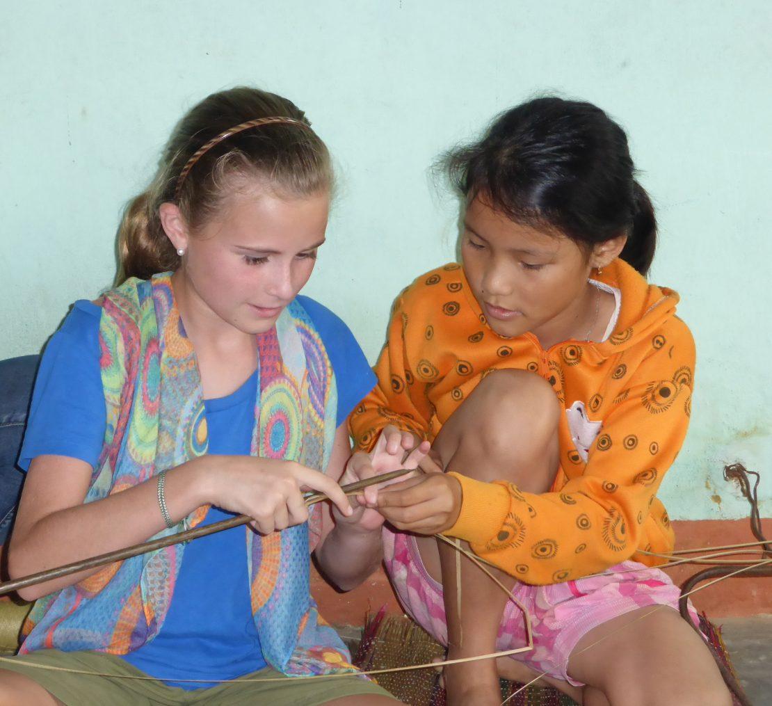 Two girls mat weaving Kim Bong Island