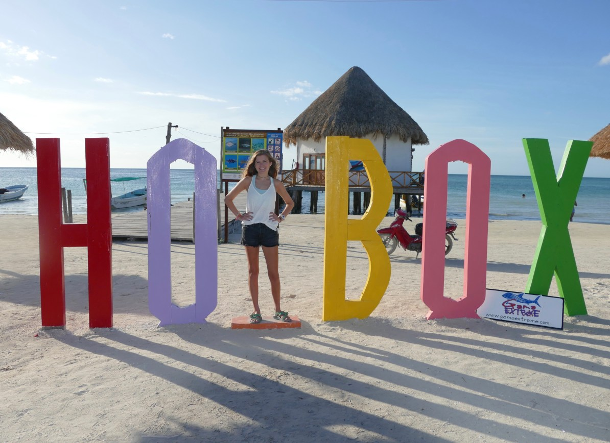 """Life sized Holbox Island sign on the beach. The space for the """"L"""" is blank so visitors can stand in its place for photo ops."""