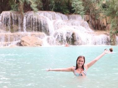 Kuang Si waterfall with teen