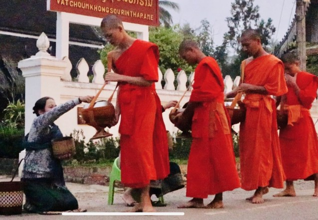 Monks collecting their morning alms
