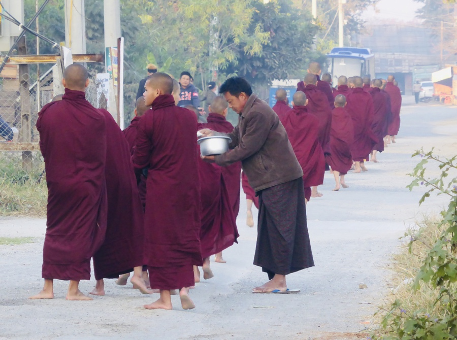 Procession of monks collecting morning alms in Nyaungshwe, Myanmar