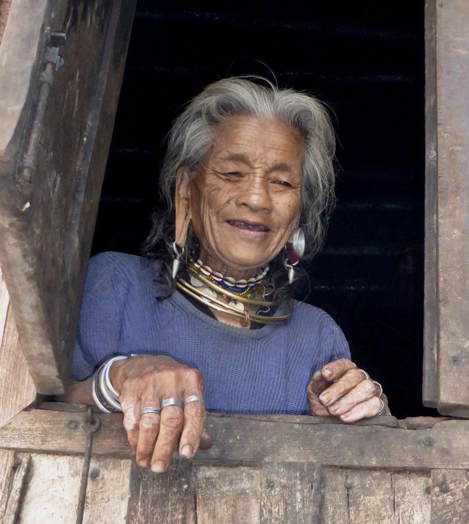 Kayaw woman peers from her window in Htay Kho Village