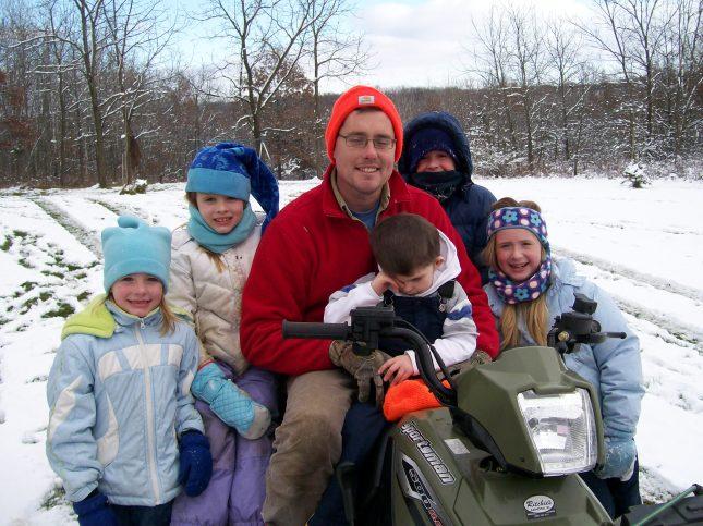 Nana and Papa's 5 grandkids 4 wheeling with Darrin. Kodi loving it!