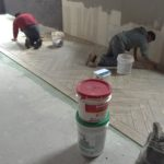 We install commercial tile. St Paul, MN tile installers laying plank floor tile.