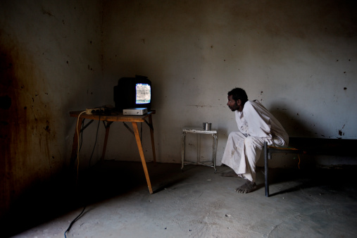 Man watching TV in Sai Island, Northern Sudan. (Getty Images)