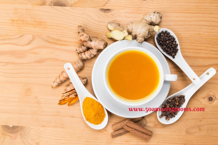 Healthy turmeric tea with black pepper, cinnamon, cloves and gin