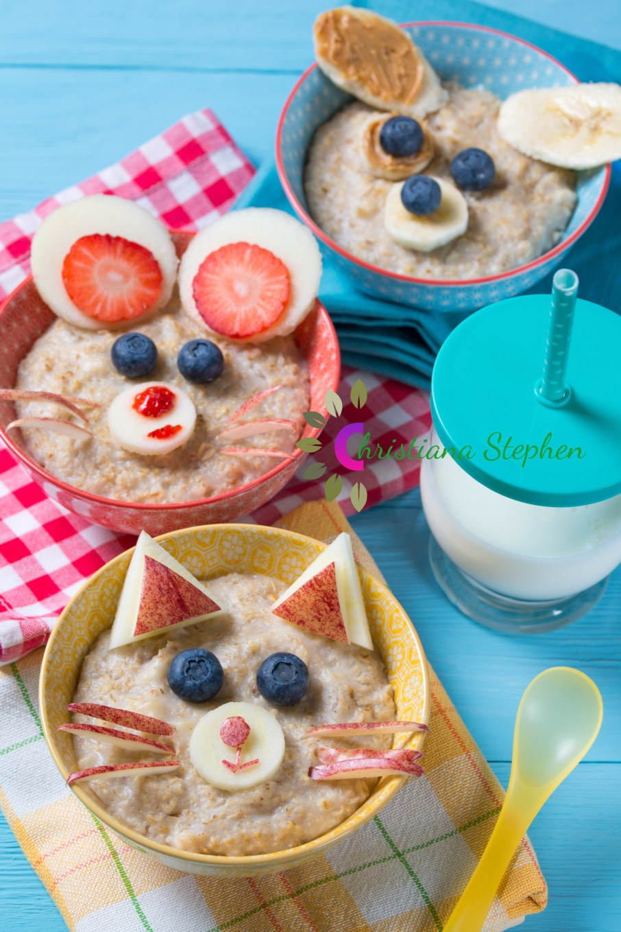 Funny bowls with oat porridge with cat, dog and mouse faces made of fruits and berries, food for kids idea
