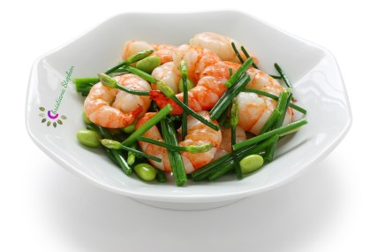 stir-fry flowering chinese chives with prawns and edamame isolated on white background