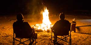 Two Men at a Campfire