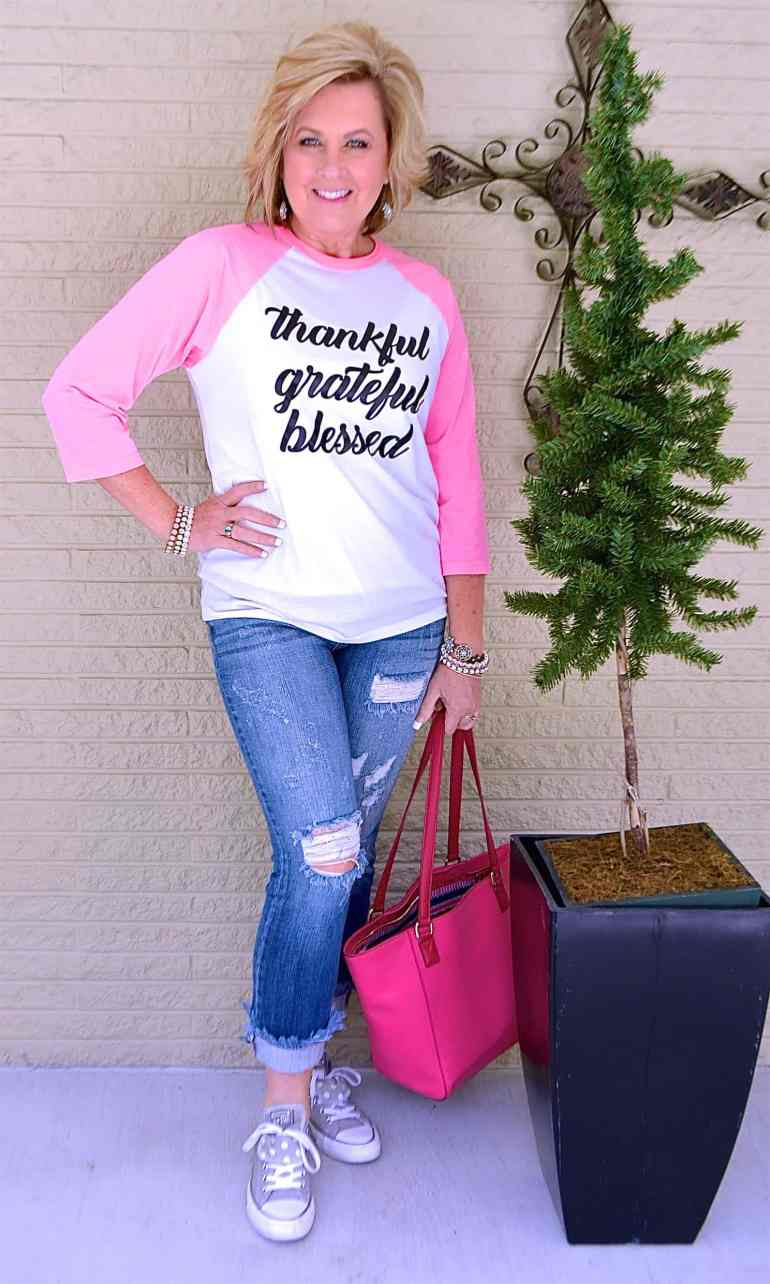50 IS NOT OLD | GRAPHIC TEE AND FRAYED JEANS