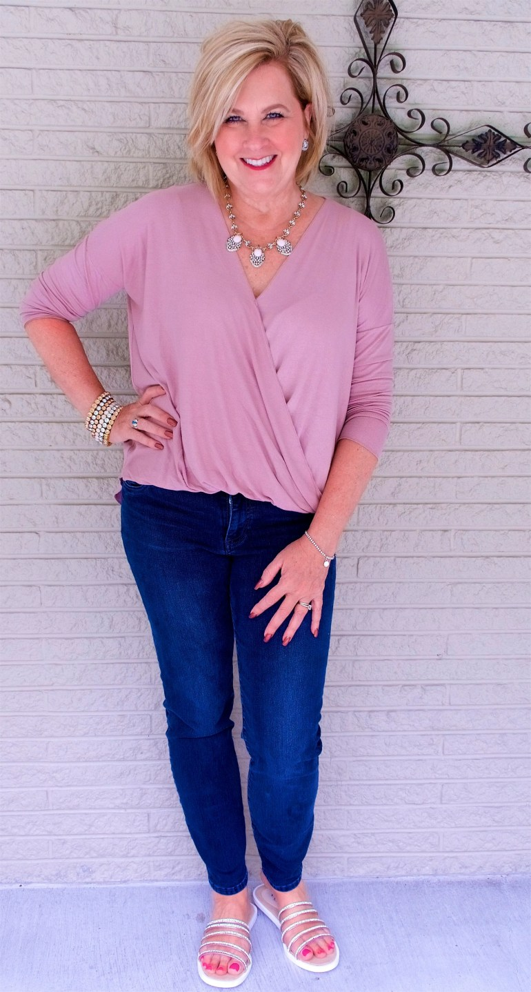 50 IS NOT OLD | BLUSH PINK WRAP TOP AND DARK WASH JEANS | FASHION OVER 40