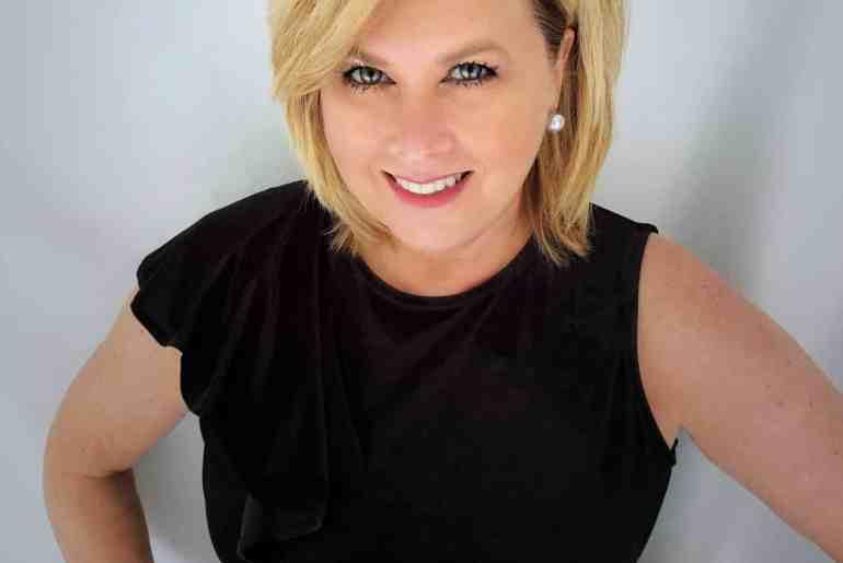 Headshot of Fashion Blogger 50 is not old wearing a black velvet sleeveless top