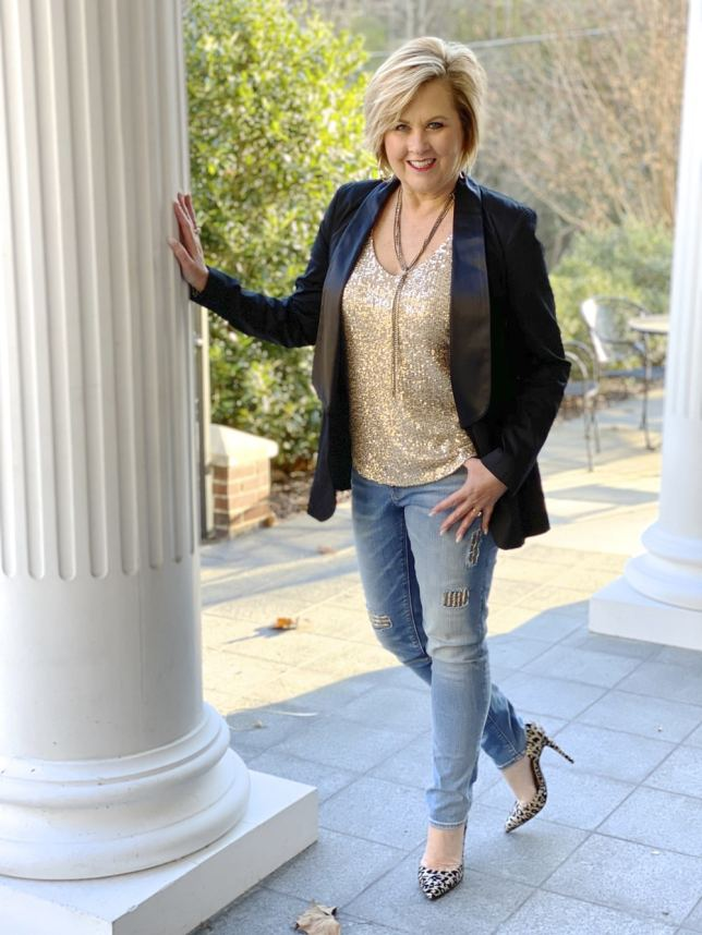 Fashion Blogger 50 Is Not Old styles a New Year's Eve outfit of a sequin top and distressed jeans