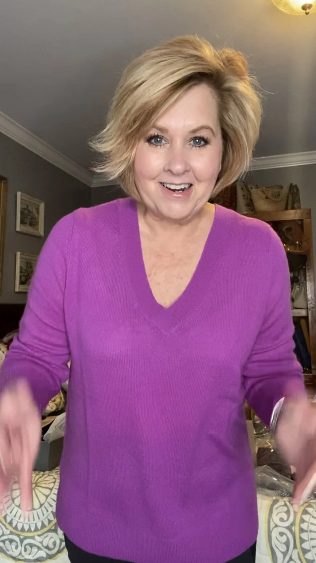 Fashion Blogger 50 Is Not Old holds a try on session with a gorgeous bright purple cashmere sweater