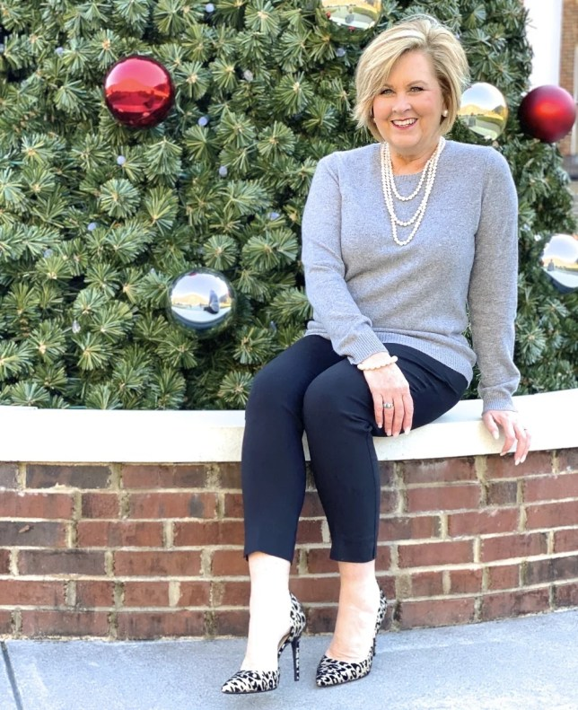 Fashion Blogger 50 Is Not Old wearing a classic cashmere sweater and black pants