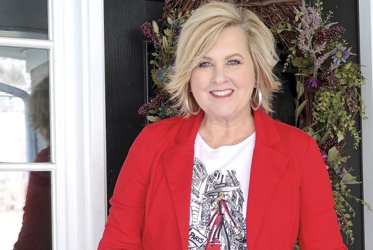 Fashion Blogger 50 Is Not Old looks stylish in a graphic tee and a red jacket