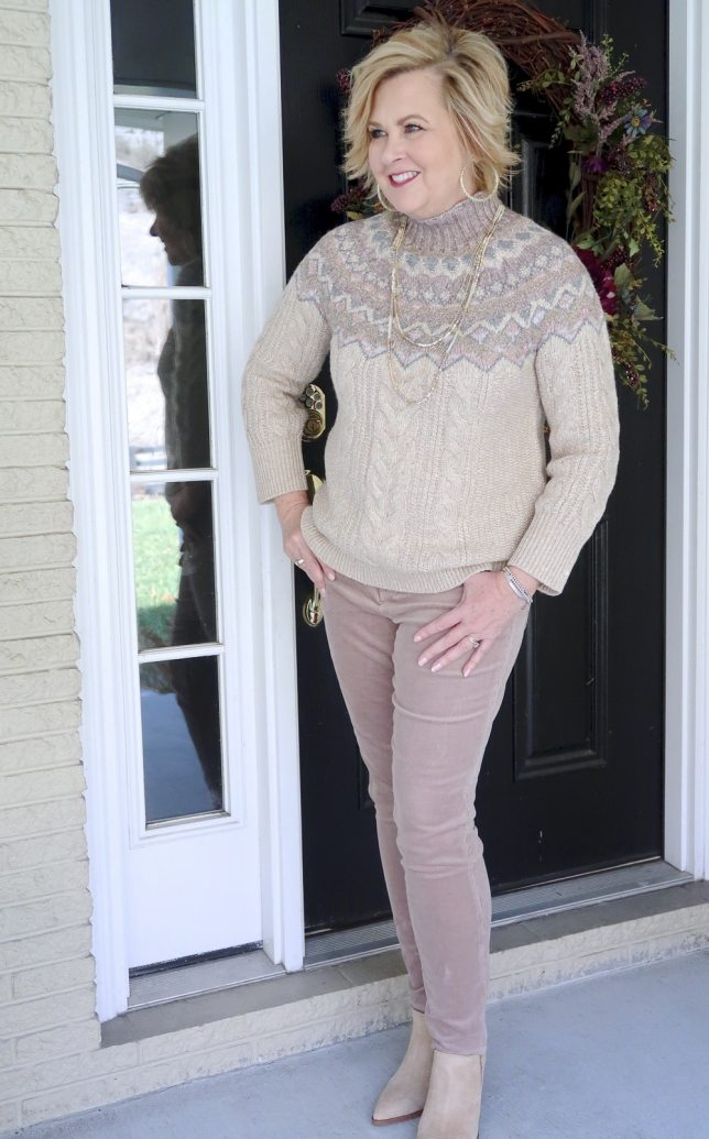 Fashion Blogger 50 Is Not Old wearing a sweater and corduroy pants in browns