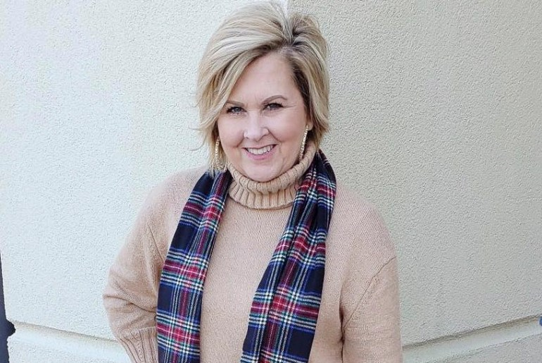 Fashion Blogger 50 is not old wearing a beige turtleneck and a plaid scarf