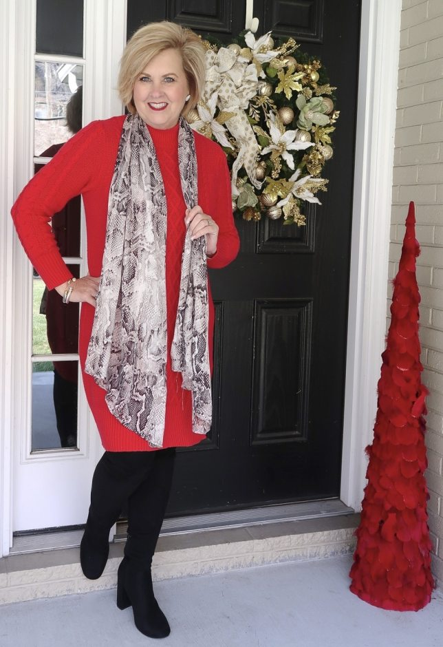 Fashion Blogger 50 is not old wearing a red sweater dress and over the knee boots