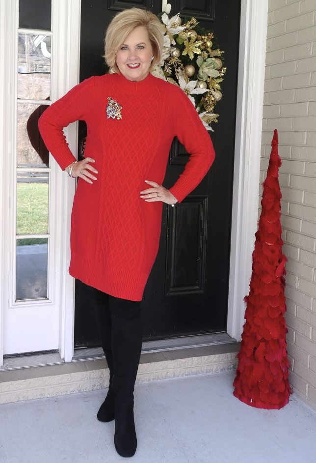 Fashion Blogger 50 is not old wearing a red sweater dress with black over the knee boots