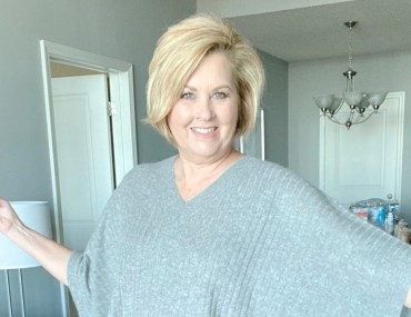 fashion blogger 50 is not old wears a gray poncho from trunk club haul