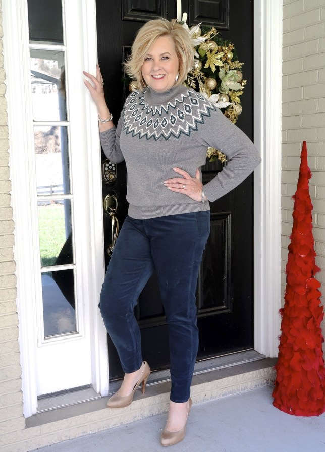 Fashion Blogger 50 Is Not Old wearing a gray sweater with teal pants and nude pumps