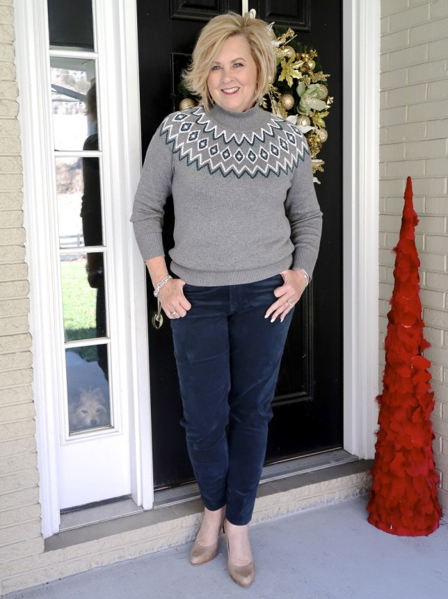 Fashion Blogger 50 Is Not Old wearing a gray sweater and corduroy pants