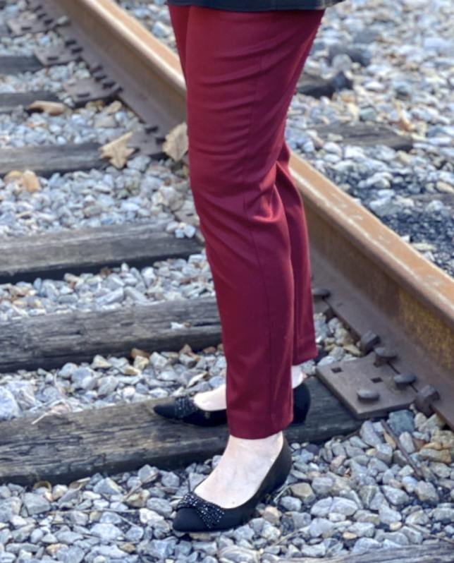 Burgundy ankle pants and black worn by Fashion Blogger 50 Is Not Old