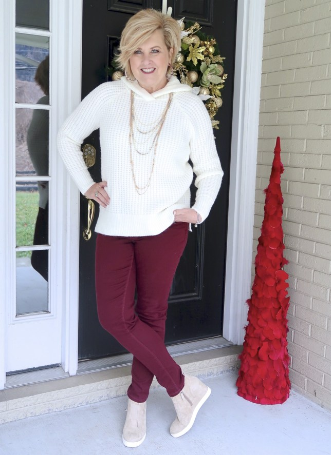 A relaxing outfit consisting of an ivory hoodie sweater by Fashion Blogger 50 Is Not Old
