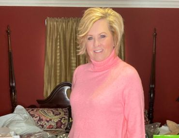 A pink turtleneck worn by fashion blogger 50 Is Not Old