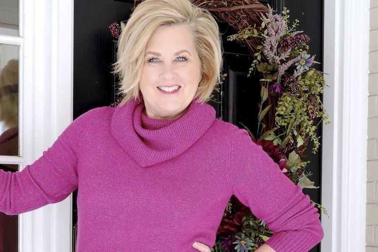 Fashion Blogger 50 Is Not Old wearing a bright colored fuchsia sweater